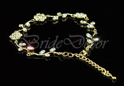 Женский браслет «Золотистые цветы»